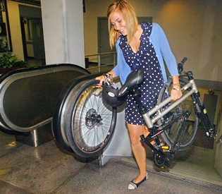 Amanda James Carrying a Swissbike TX folding bike