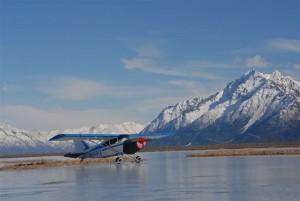 Plane lands on frozen pond