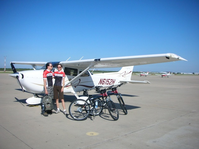 Montague X70 folding bikes in front of Cessna