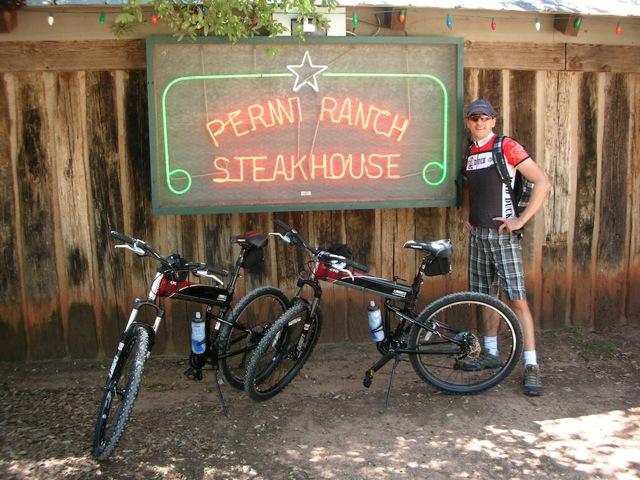 X70 folding bike in front of steak house