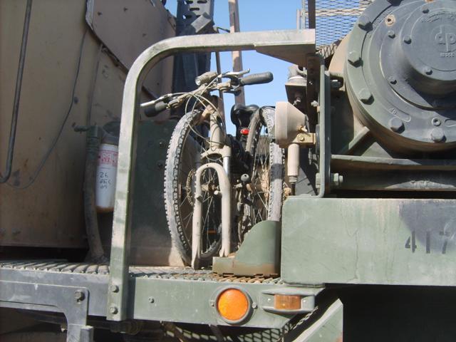 Paratrooper folding bike on vehicle