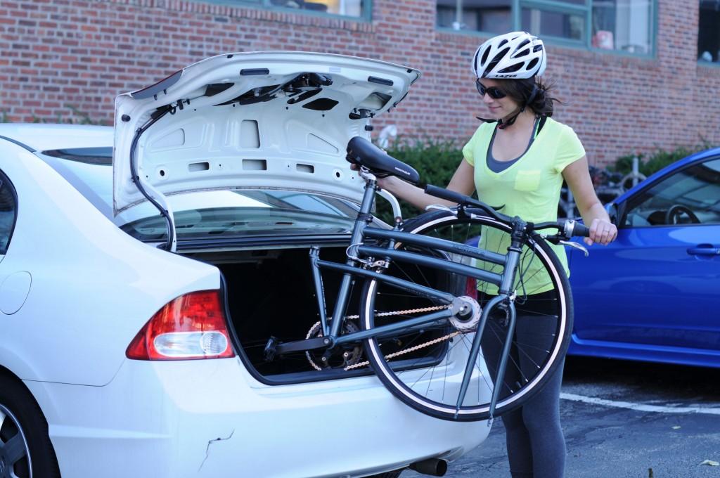 bike in white car trunk nice smile