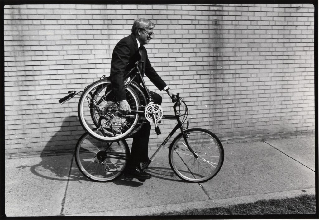 Harry-Montague-rides-and-holds-a-folded-bike