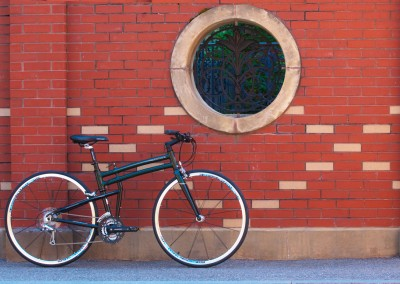 2015 Montague FIT folding bike against brick wall