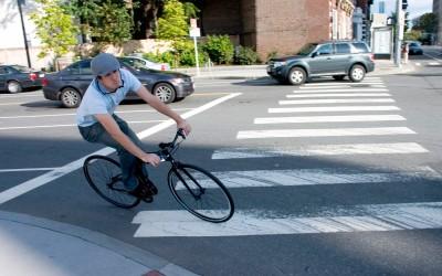 boston-folding-bike-riding-in-street