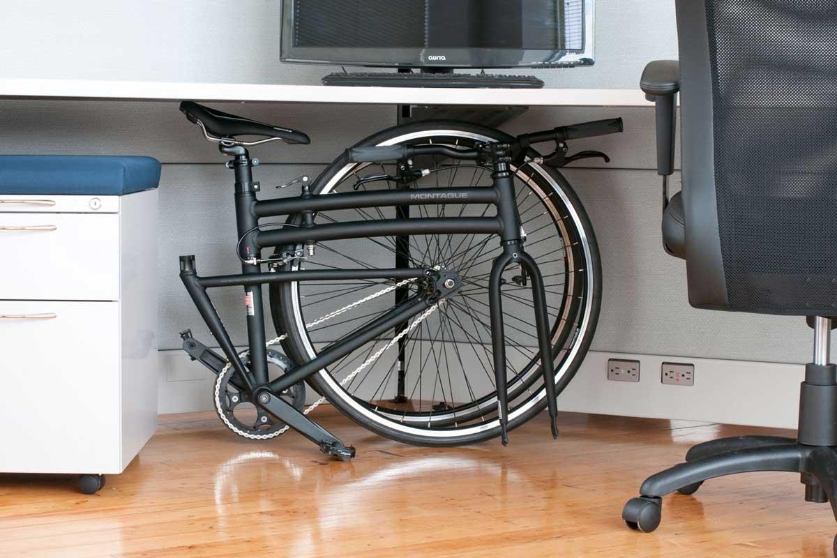 boston folding bike under desk in office