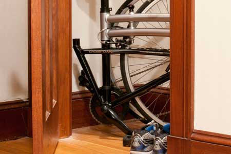 Folding Bike in Closet of Apartment