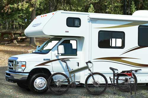 A Montague folding bike with a RV camper