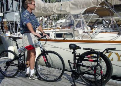 mx and dx folding bikes near boat