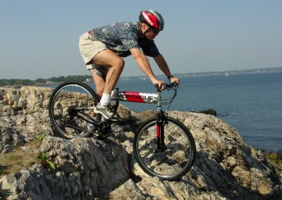 mx folding mountain bike on rocks
