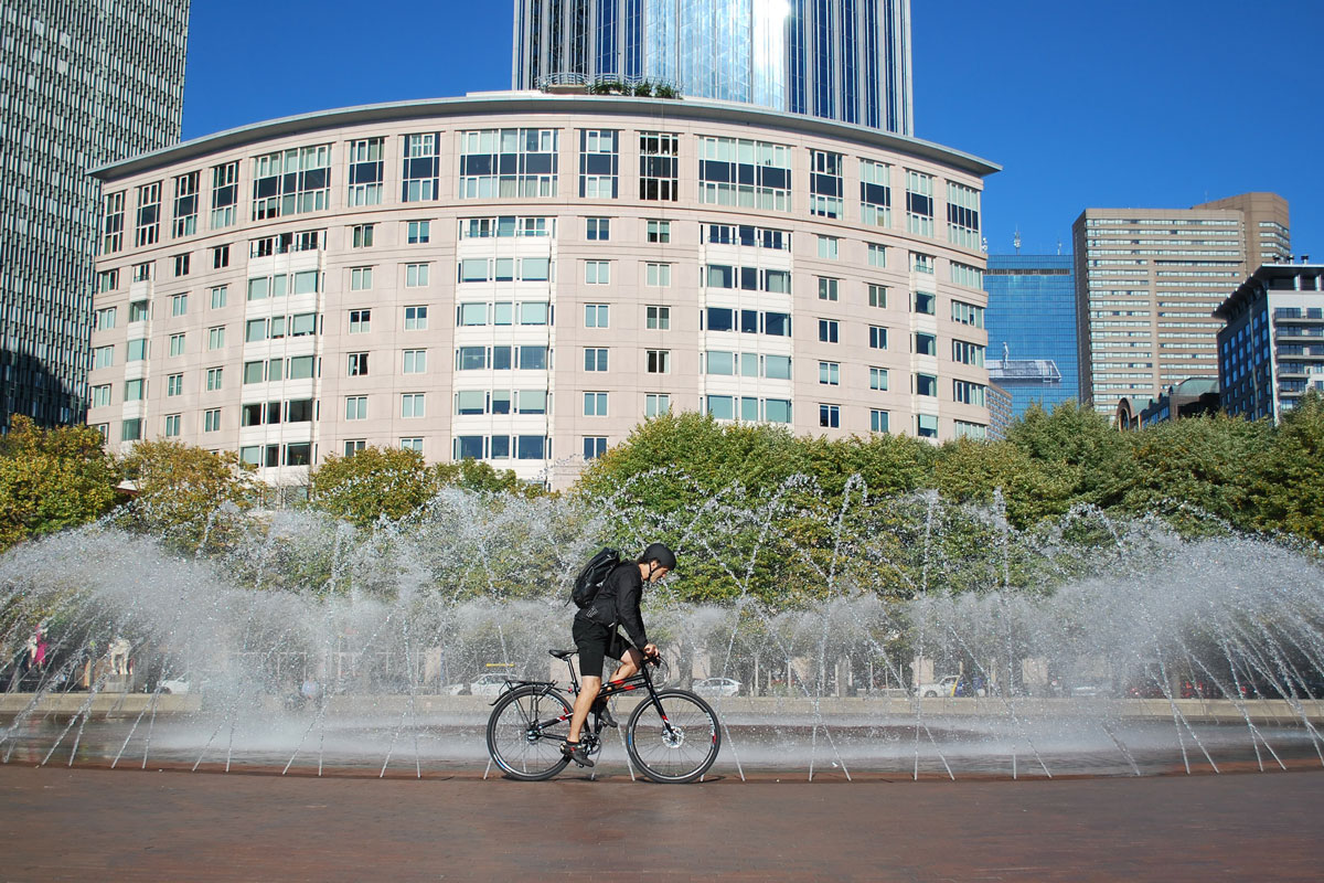Montague-Allston-riding-by-fountain-in-boston