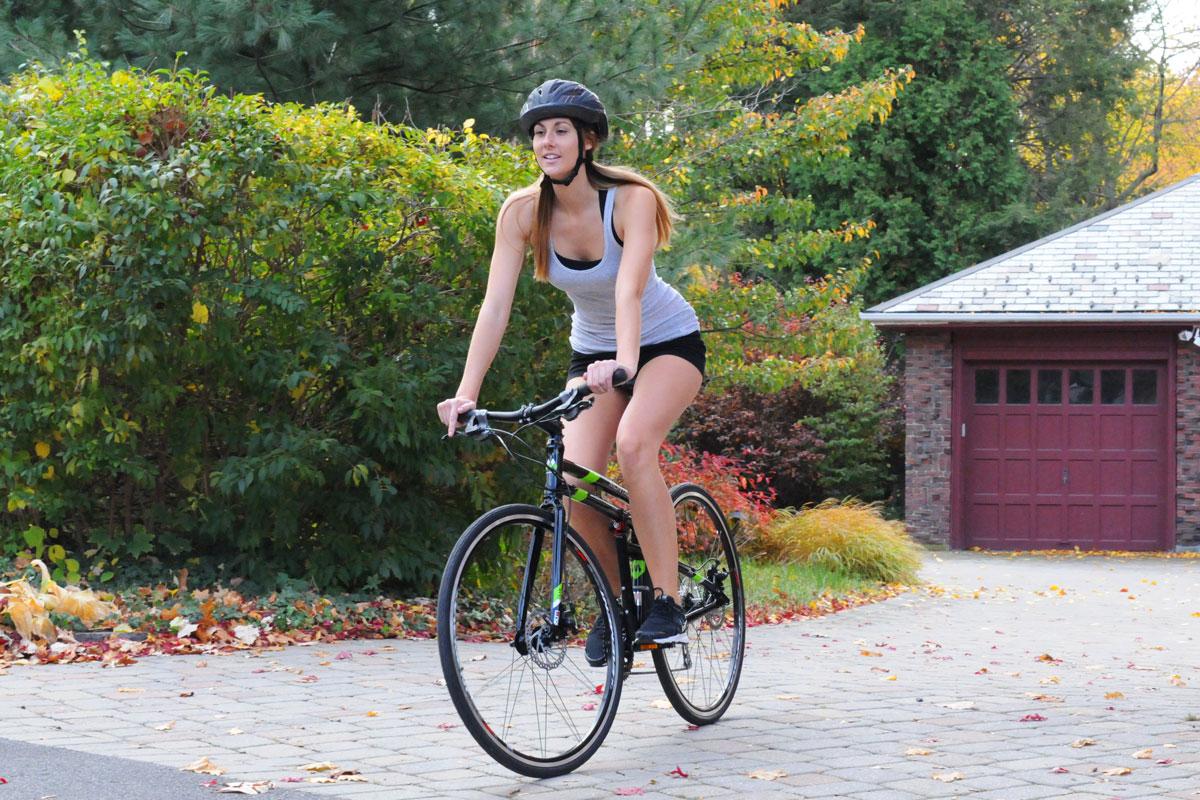 FIT-woman-riding-toward-camera