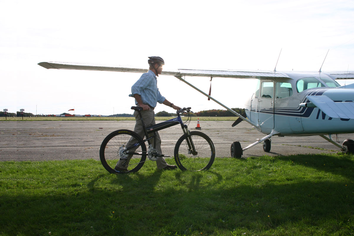 Montague Folding Bike near Aircraft