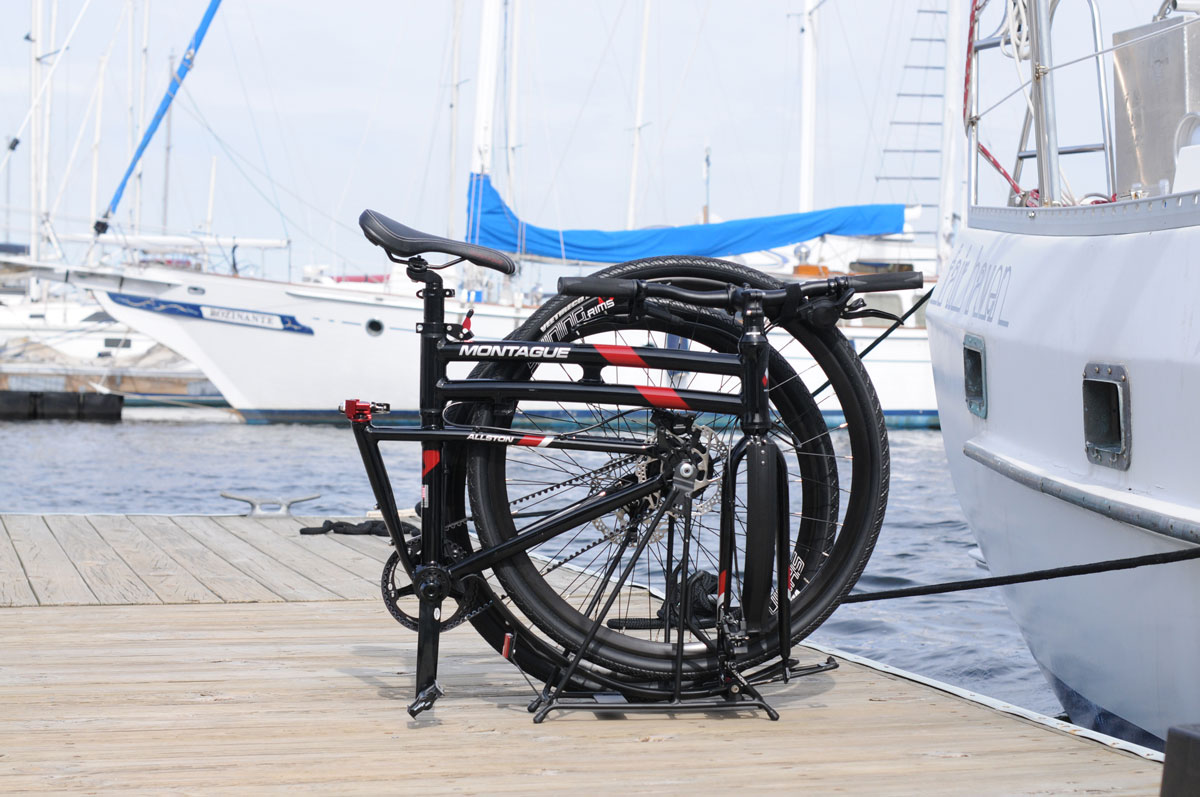 Montague Allston Folding Bike at Marina near Sailboats